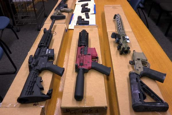 FILE - This Nov. 27, 2019, file photo shows ghost guns on display at the headquarters of the San Francisco Police Department in San Francisco. A federal appeals court in San Francisco has ruled that plans for 3D-printed, self-assembled ghost guns can be posted online without U.S. State Department approval. The San Francisco Chronicle says the 2-1 decision was made Tuesday, April 27, 2021, by the 9th U.S. District Court of Appeals. (AP Photo/Haven Daley, File)