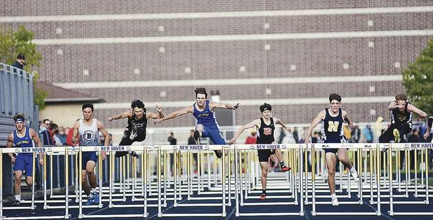 Katie Fyfe   The Journal Gazette Runners head down the track during the boys 110-meter high hurdles finals at the NE8 Track and Field Championships on Friday night in New Haven.
