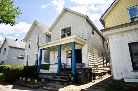 Katie Fyfe | The Journal Gazette  Blue pillars set off the home at 801 Third St. on the city's near north side where many calls to police were made in the last year. On April 30, it was raided and condemned.