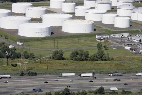 In this Sept. 8, 2008 file photo traffic on I-95 passes oil storage tanks owned by the Colonial Pipeline Company in Linden, N.J. (AP Photo/Mark Lennihan, File)