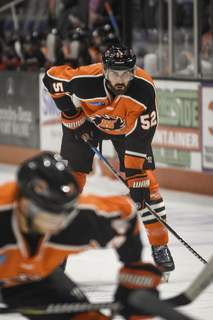 Mike Moore | The Journal Gazette Komets defenseman Mathieu Brodeur watches for the puck to drop in the first period against Indy at Memorial Coliseum on Saturday.