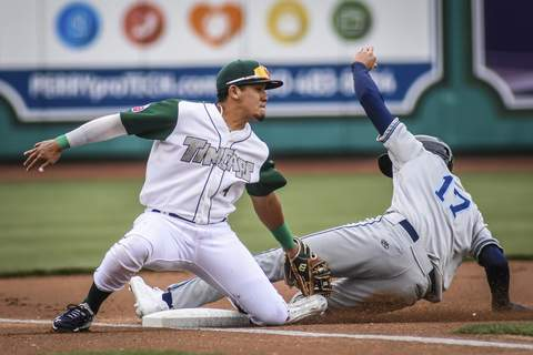 Mike Moore | The Journal Gazette TinCaps third baseman Kelvin Melean tags Whitecaps center fielder Parker Meadows for the out while he slides into base in the first inning on Saturday.