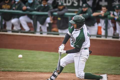 Mike Moore | The Journal Gazette TinCaps right fielder Agustin Ruiz batting in the second inning against West Michigan at Parkview Field on Saturday.