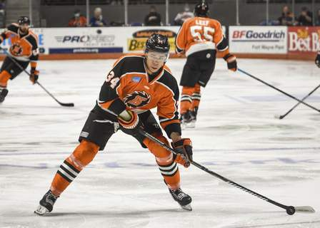 Mike Moore | The Journal Gazette Komets forward Stephen Harper controls the puck in the first period against Indy at Memorial Coliseum on Saturday.