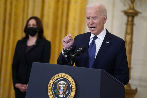 Vice President Kamala Harris listens as President Joe Biden speaks about the economy, in the East Room of the White House, Monday, May 10, 2021, in Washington. (AP Photo/Evan Vucci)