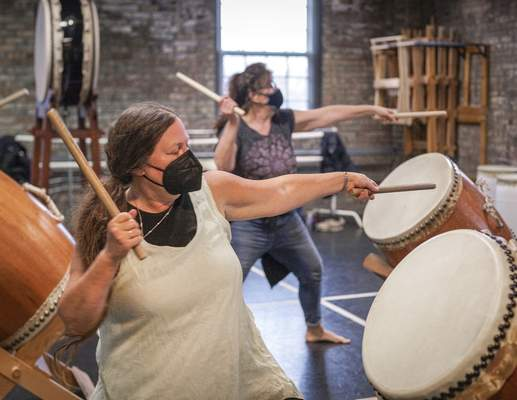 Allison Ballard, left, started the local Taiko drumming group. She made drums from used whiskey barrels.