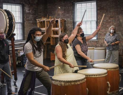 Mike Moore   The Journal Gazette Members of the Fort Wayne Taiko Drum Corps, from the left, Karen Goss, Wolfgang Young, Allison Ballard, Beth Fenstermacher and Chris Johnson, practice at the Fort Wayne Dance Collective on E. Berry St. on Friday 03.26.21