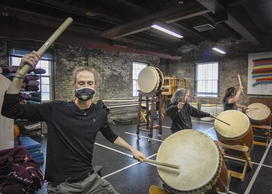 Members of the Fort Wayne Taiko Drum Corps, from the left, Jack Fisher, Karen Goss and Beth Fenstermacher, practice on March 26.