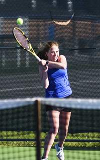 Katie Fyfe | The Journal Gazette  Homestead's Olivia Creech competes in a varsity singles match against Carroll's Maggie Brennan at Carroll High School on Tuesday.
