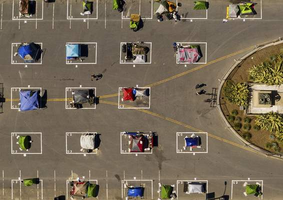 FILE - In this May 21, 2020, file photo, rectangle areas designed to help prevent the spread of the coronavirus by encouraging social distancing line a city-sanctioned homeless encampment at San Francisco's Civic Center. (AP Photo/Noah Berger, File)