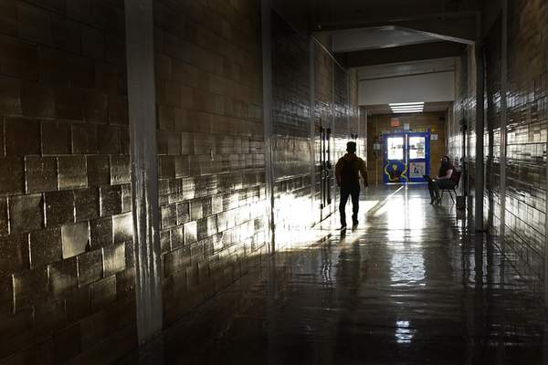 A student walks between classes at Wyandotte High School in Kansas City, Kan., on the first day of in-person learning Wednesday, March 30, 2021. (AP Photo/Charlie Riedel)
