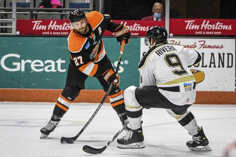 Mike Moore | The Journal Gazette Komets forward Shawn Szydlowski takes a shot in the first period against Wheeling at Memorial Coliseum this season.