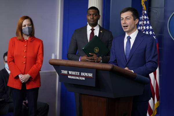 Secretary of Transportation Secretary Pete Buttigieg listens during a press briefing at the White House, Wednesday, May 12, 2021, in Washington. (AP Photo/Evan Vucci)