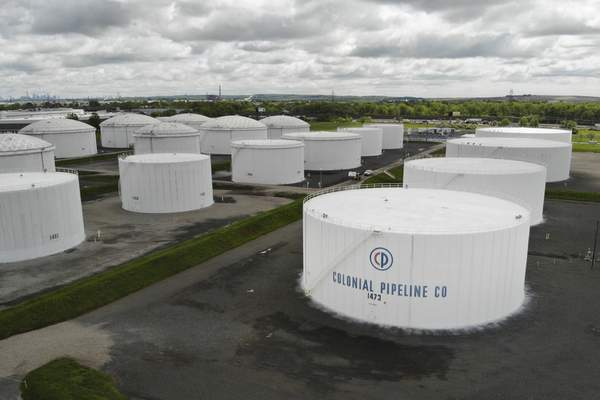 Colonial Pipeline storage tanks are seen in Woodbridge, N.J., Monday, May 10, 2021. (AP Photo/Ted Shaffrey)