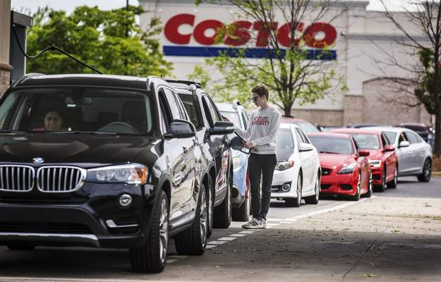 Numerous vehicles line up for gasoline at Costco on Wendover Avenue in Greensboro, N.C., on Tuesday, May 11, 2021. (Woody Marshall/News & Record via AP)
