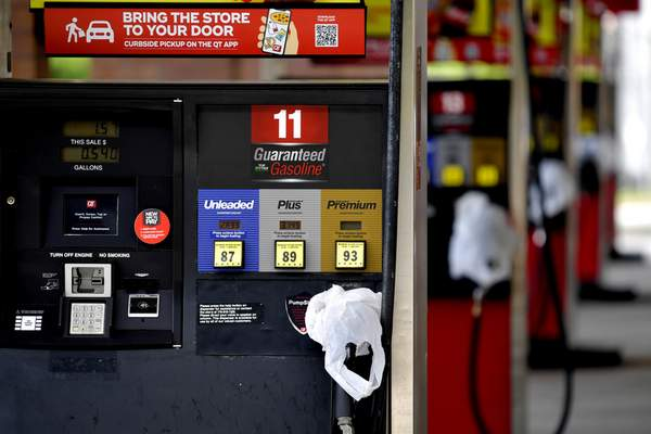 A QuickTrip connivence store has bags on their pumps as the station has no gas, Tuesday, May 11, 2021, in Kennesaw, Ga. (AP Photo/Mike Stewart)