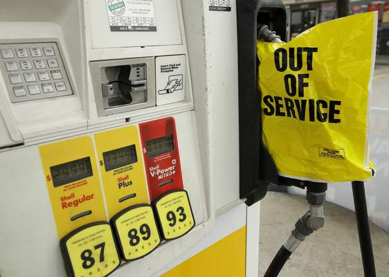 A gasoline station that ran out of gas for sale displays an out of service sign on the pump on Tuesday, May 11, 2021, in Atlanta. (AP Photo/Ben Margot)