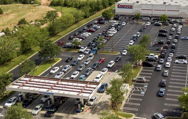 In this aerial image taken with a drone, numerous vehicles line up for gasoline at Costco on Wendover Avenue in Greensboro, N.C., on Tuesday, May 11, 2021. (Woody Marshall/News & Record via AP)