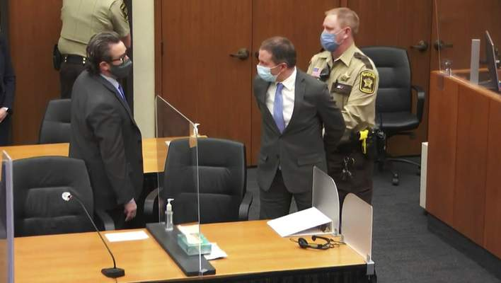 FILE - In this April 20, 2021 file image from video, former Minneapolis police Officer Derek Chauvin, center, is taken into custody as his attorney, Eric Nelson, left, looks on, after the verdicts were read at Chauvin's trial for the 2020 death of George Floyd, at the Hennepin County Courthouse in Minneapolis, Minn. (Court TV via AP, Pool, File)