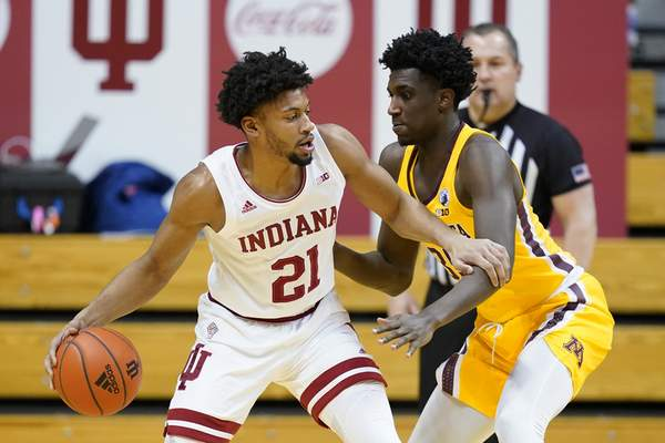Indiana's Jerome Hunter (21) is defended by Minnesota's Isaiah Ihnen (35) during the first half of an NCAA college basketball game, Wednesday, Feb. 17, 2021, in Bloomington, Ind. (AP Photo/Darron Cummings)