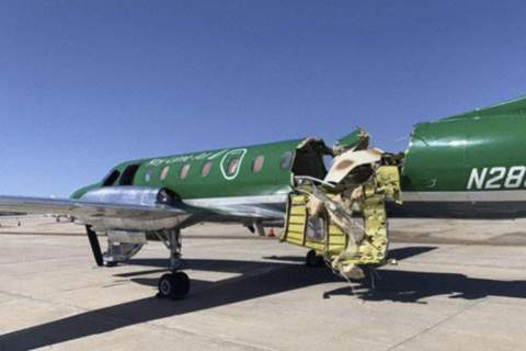 Airplane Collision Colorado This image from CBS Denver shows a Key Lime Air Metroliner that landed safely at Centennial Airport after a mid-air collision near Denver on Wednesday, May 12, 2021. (CBS Denver via AP) (TEL)