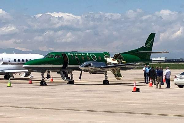 This image from CBS Denver shows a Key Lime Air Metroliner that landed safely at Centennial Airport after a mid-air collision near Denver on Wednesday, May 12, 2021. (CBS Denver via AP)