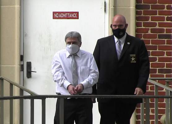 In this image from video, Roddy Bryant, accused in the slaying of Ahmaud Arbery, is led by security officers from the Glynn County Courthouse in Brunswick, Ga., Wednesday, May 12, 2021. (AP Photo/Lewis M. Levine)