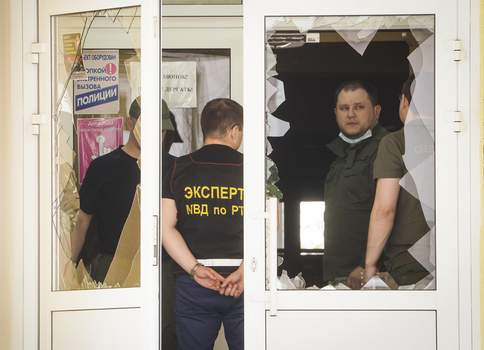 Russia School Shooting Police investigators work at the scene after a shooting on Tuesday in Kazan, Russia, Thursday, May 13, 2021. (AP Photo/Dmitri Lovetsky) (Dmitri Lovetsky STF)