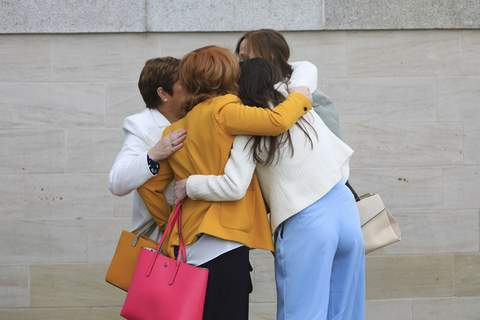 Britain Troubles Deaths FILE - In this Tuesday May 11, 2021 file photo, family members of John Laverty comfort each other as they arrive for an inquest in Belfast, Northern Ireland. (AP Photo/Peter Morrison, File) (Peter Morrison STR)