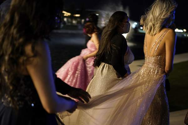 Young people attend prom at the Grace Gardens Event Center in El Paso, Texas on Friday, May 7, 2021. (AP Photo/Paul Ratje)