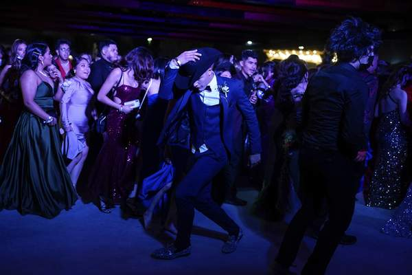 Young people dance during prom at the Grace Gardens Event Center in El Paso, Texas on Friday, May 7, 2021. (AP Photo/Paul Ratje)
