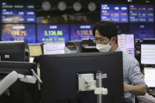 South Korea Financial Markets A currency trader watches monitors at the foreign exchange dealing room of the KEB Hana Bank headquarters in Seoul, South Korea, Thursday, May 13, 2021. (AP Photo/Ahn Young-joon) (Ahn Young-joon STF)