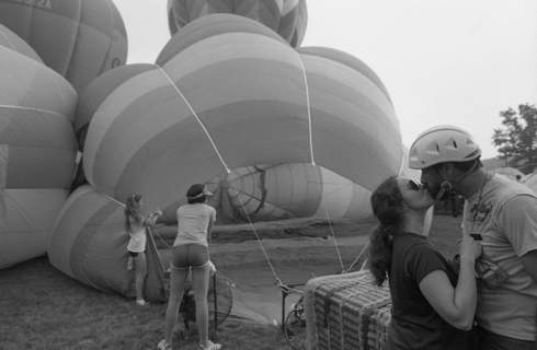 July 17, 1982: Pilot Jim Martin gets a kiss from his wife, Bunny, before a hot air balloon race that was part of Three Rivers Festival. (Journal Gazette file photo)