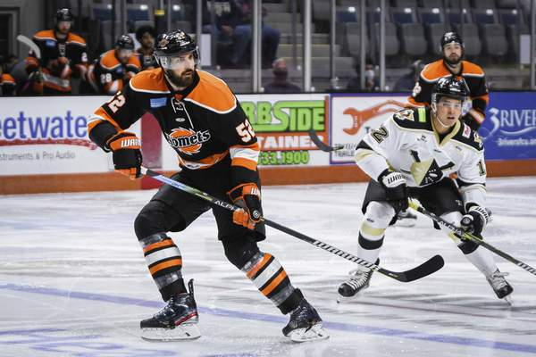Mike Moore   The Journal Gazette Komets defenseman Mathieu Brodeur, left watches for the puck in the first period against Wheeling at Memorial Coliseum on Friday.