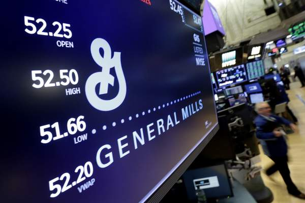 FILE - In this Feb. 23, 2018 file photo, the logo for General Mills appears above a trading post on the floor of the New York Stock Exchange. General Mills is diving further into the red-hot pet food market, acquiring Tyson Foods' pet treat business for $1.2 billion in cash, the companies said Friday, May 14, 2021. (AP Photo/Richard Drew, File)