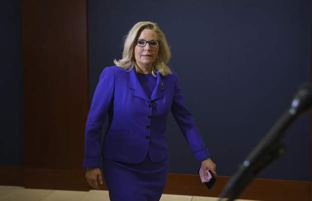 Rep. Liz Cheney, R-Wyo., arrives to speak to reporters after House Republicans voted to oust her from her leadership post as chair of the House Republican Conference because of her repeated criticism of former President Donald Trump for his false claims of election fraud and his role in instigating the Jan. 6 U.S. Capitol attack, at the Capitol in Washington, Wednesday, May 12, 2021. (AP Photo/J. Scott Applewhite)