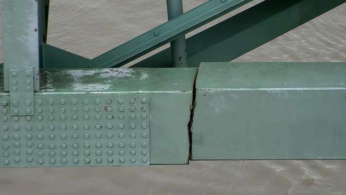 In this undated image released by the Tennessee Department of Transportation shows a crack is in a steel beam on the Interstate 40 bridge, near Memphis, Tenn. The Tennessee Department of Transportation says the crack is in a 900-foot steel beam that provides stability for the Interstate 40 bridge that connects Arkansas and Tennessee over the Mississippi River. The bridge was closed Tuesday, May 11, 2021 after inspectors found the crack. (Tennessee Department of Transportation via AP)
