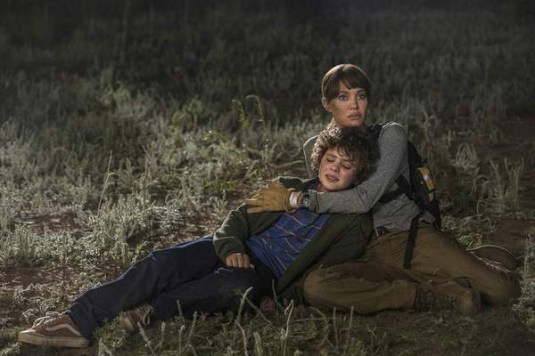 This image released by Warner Bros. Entertainment shows Angelina Jolie and Finn Little in a scene from Those Who Wish Me Dead. (Emerson Miller/Warner Bros. Entertainment via AP)