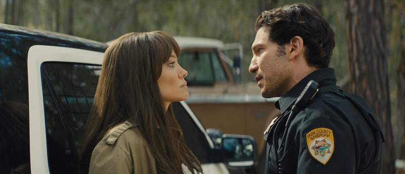 This image released by Warner Bros. Entertainment shows Angelina Jolie, left, and Jon Bernthal in a scene from Those Who Wish Me Dead. (Emerson Miller/Warner Bros. Entertainment via AP)