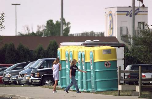 June 3, 1998: Students at Homestead High School use portable toilets because of low water pressure in Abboite Township. (Journal Gazette file photo)