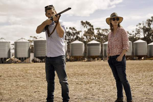 This image released by IFC Films shows Eric Bana, left, and Genevieve O'Reilly in a scene from The Dry. (Ben King/IFC Films via AP)
