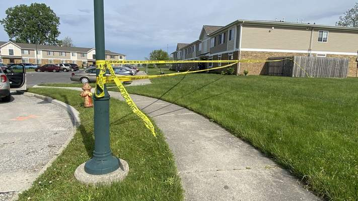 Michelle Davies   The Journal Gazette Police tape stretches across an area at the Villages of Hanna apartments where a shooting left one person dead today.