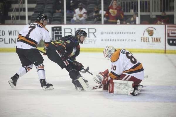Whiteshark Photography  Komets goaltender Robbie Beydoun, right, stops the Indy Fuel's Tommy Apap at the end of a breakaway rush Friday as Brandon Hawkins trails the play at Indiana Farmers Coliseum in Indianapolis.