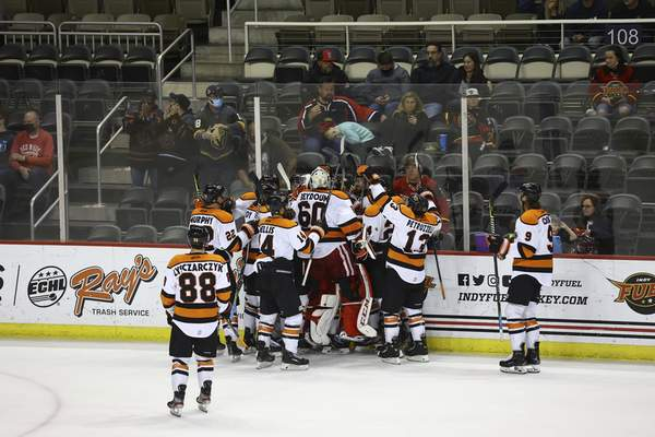 Whiteshark Photography The Komets celebrate Brandon Hawkins' overtime goal Friday at Indiana Farmers Coliseum in Indianapolis.