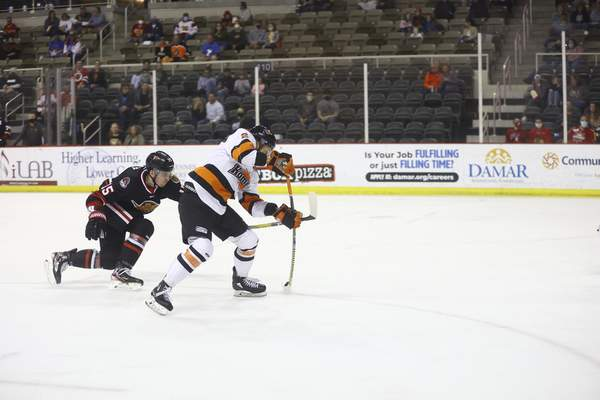 Whiteshark Photography  The Komets' Marco Roy attempts to shoot on a breakaway Saturday as the Indy Fuel's Dmitry Osipov defends at Indiana Farmers Coliseum in Indianapolis.