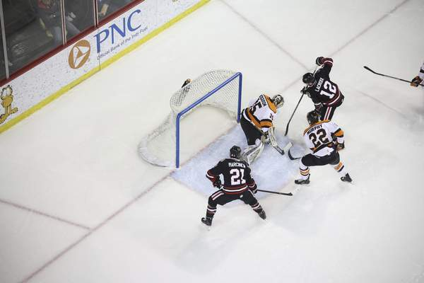 Whiteshark Photography  Komets goaltender Dylan Ferguson, top middle, and defenseman Matt Murphy protect the net Saturday from the Indy Fuel's Matt Marcinew, bottom, and Cedric Lacroix in Indianapolis.