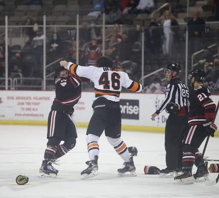 Whiteshark Photography  The Komets' Justin Vaive, middle, fights the Indy Fuel's Nick Hutchison on Saturday at Indiana Farmers Coliseum in Indianapolis.