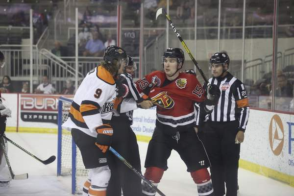 Whiteshark Photography  Komets forward Oliver Cooper, left, scuffles with the Indy Fuel's Dmitry Osipov on Monday at Indianapolis.