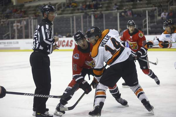 Whiteshark Photography  Komets forward Anthony Nellis tries to win a faceoff against the Indy Fuel's Nic Pierog, after linesman Christopher Williams drops the puck Monday in Indianapolis.