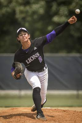 Mike Moore | The Journal Gazette Leo starter Tyler Papenbrock pitched a complete game Monday as the Lions beat Bishop Luers to win the Class 3A Garrett Sectional.